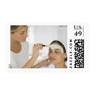 Woman getting beauty mud mask stamp