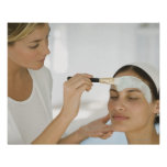 Woman getting beauty mud mask print