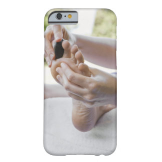 Woman getting foot massage with hot stone barely there iPhone 6 case