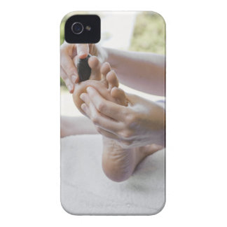 Woman getting foot massage with hot stone iPhone 4 cover
