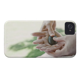 Woman getting hand massage with hot stone iPhone 4 cover