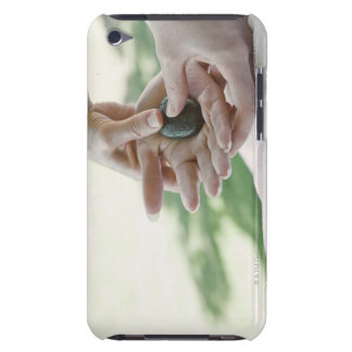 Woman getting hand massage with hot stone iPod touch cover