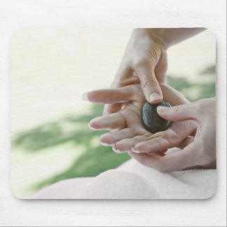 Woman getting hand massage with hot stone mouse pad