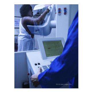 Woman getting mammogram postcard