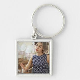 Woman Getting Manicure Keychain