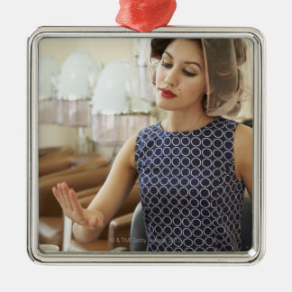 Woman Getting Manicure Metal Ornament