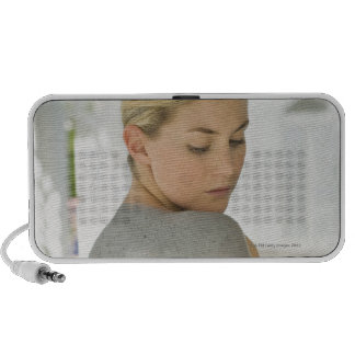Woman getting spa skin treatment iPod speaker