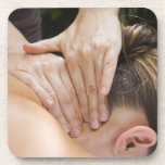 Woman getting spa treatment beverage coaster
