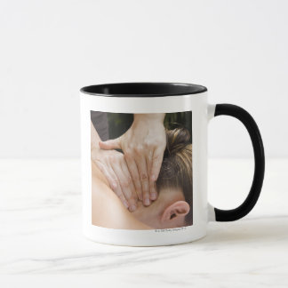 Woman getting spa treatment mug
