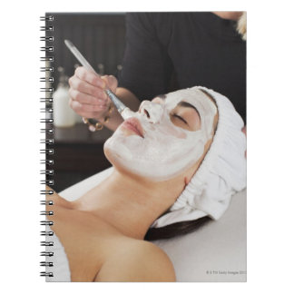 Woman Getting Spa Treatment. Notebook