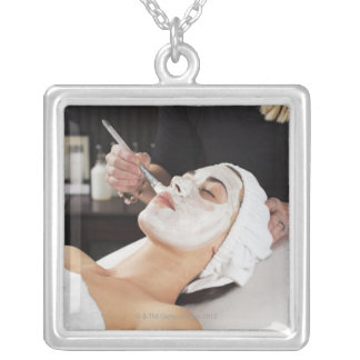 Woman Getting Spa Treatment. Silver Plated Necklace
