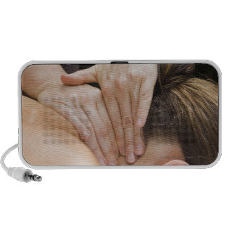 Woman getting spa treatment notebook speakers