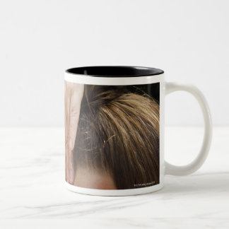 Woman getting spa treatment Two-Tone coffee mug