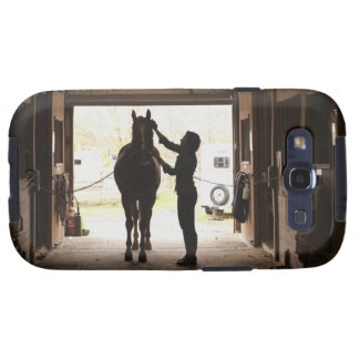 Woman grooming horse galaxy SIII cover