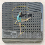 Woman gymnast outdoors on rooftop jumping in air drink coaster