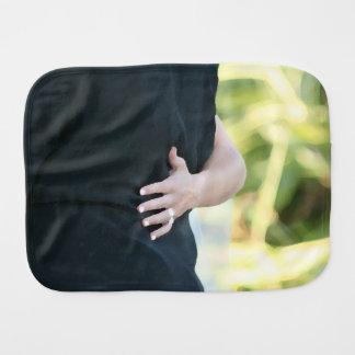 woman hand on black jacket man burp cloths