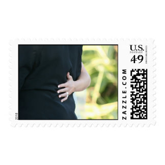 woman hand on black jacket man postage stamp