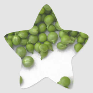Woman hands are shelling green peas on a plate star sticker