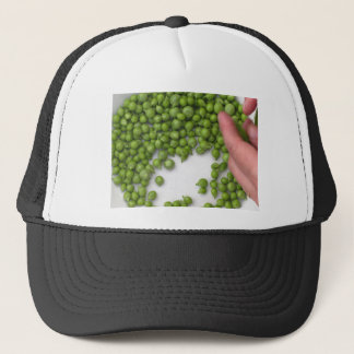 Woman hands are shelling green peas on a plate trucker hat