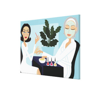 Woman having manicure and facial at spa canvas print