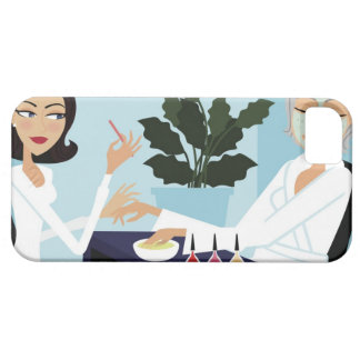 Woman having manicure and facial at spa iPhone 5 covers