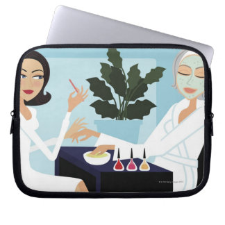 Woman having manicure and facial at spa laptop sleeve