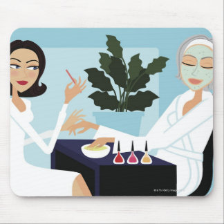 Woman having manicure and facial at spa mousepads
