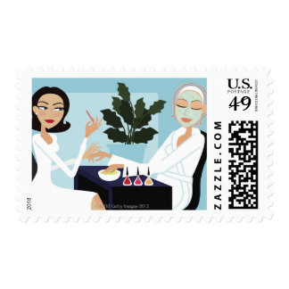 Woman having manicure and facial at spa postage stamps