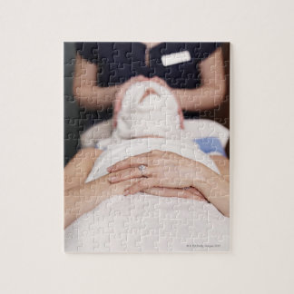 Woman having s[a treatment jigsaw puzzle