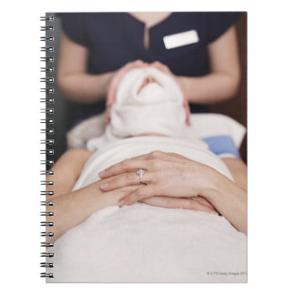 Woman having s[a treatment notebook