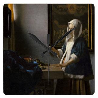 Woman Holding a Balance by Johannes Vermeer Wallclock