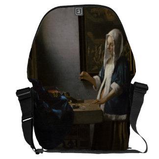 Woman Holding a Balance by Johannes Vermeer Messenger Bag