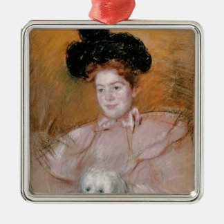 Woman holding a dog metal ornament