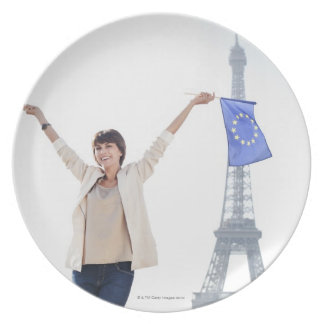 Woman holding a European Union flag and a French Melamine Plate