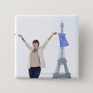 Woman holding a European Union flag and a French Pinback Button