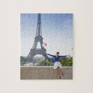 Woman holding a French flag sitting on a stone 2 Jigsaw Puzzle