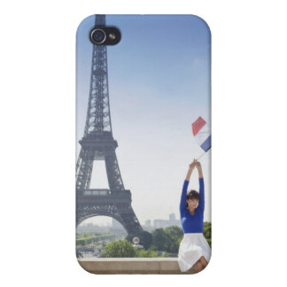 Woman holding a French flag sitting on a stone iPhone 4/4S Covers