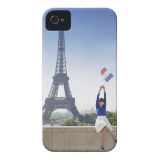 Woman holding a French flag sitting on a stone iPhone 4 Cover