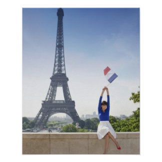Woman holding a French flag sitting on a stone Poster