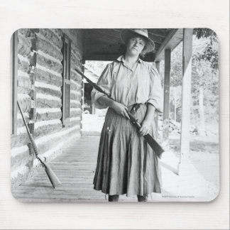 Woman holding a rifle on a porch mouse pad