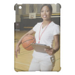 Woman holding basketball and clipbpard, smiling, case for the iPad mini