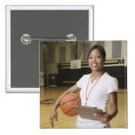 Woman holding basketball and clipbpard, smiling, pinback button