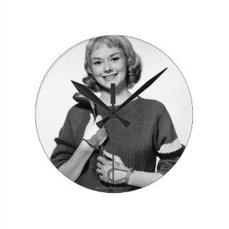 Woman Holding Golf Club Round Clock