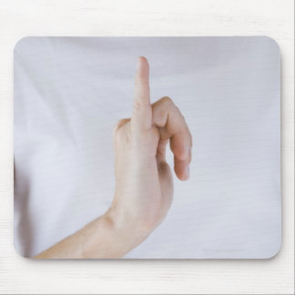 Woman holding hand up with outstretched small mouse pad
