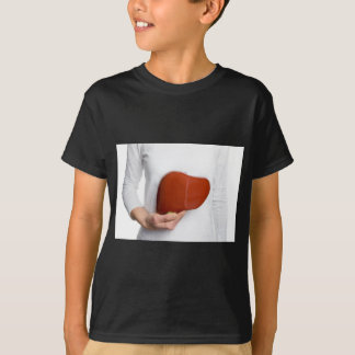 Woman holding human liver model at white body T-Shirt