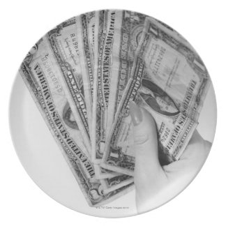 Woman Holding Money Dinner Plate