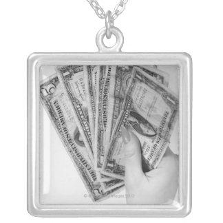 Woman Holding Money Square Pendant Necklace