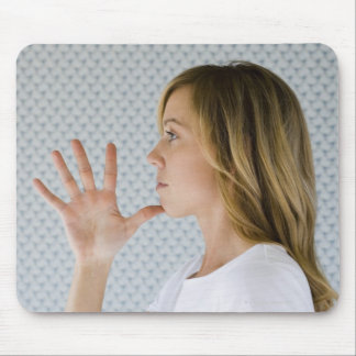 Woman holding open hand to chin. mouse pad