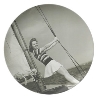 Woman Holding Rigging on Yacht Dinner Plate