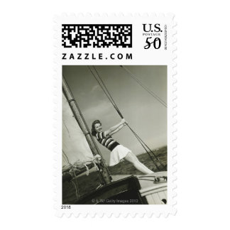 Woman Holding Rigging on Yacht Postage
